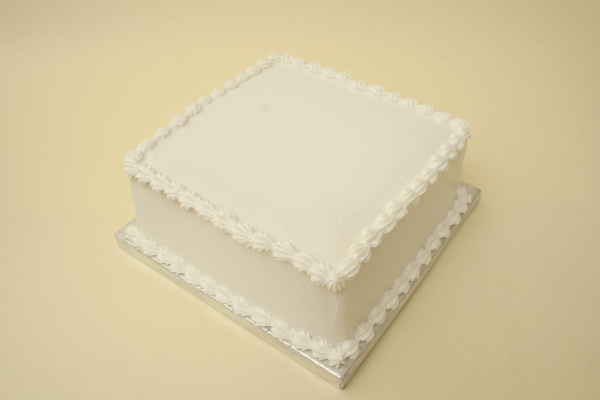 https://caroldeaconcakes.com/tutorials/royal-icing-a-square-cake/