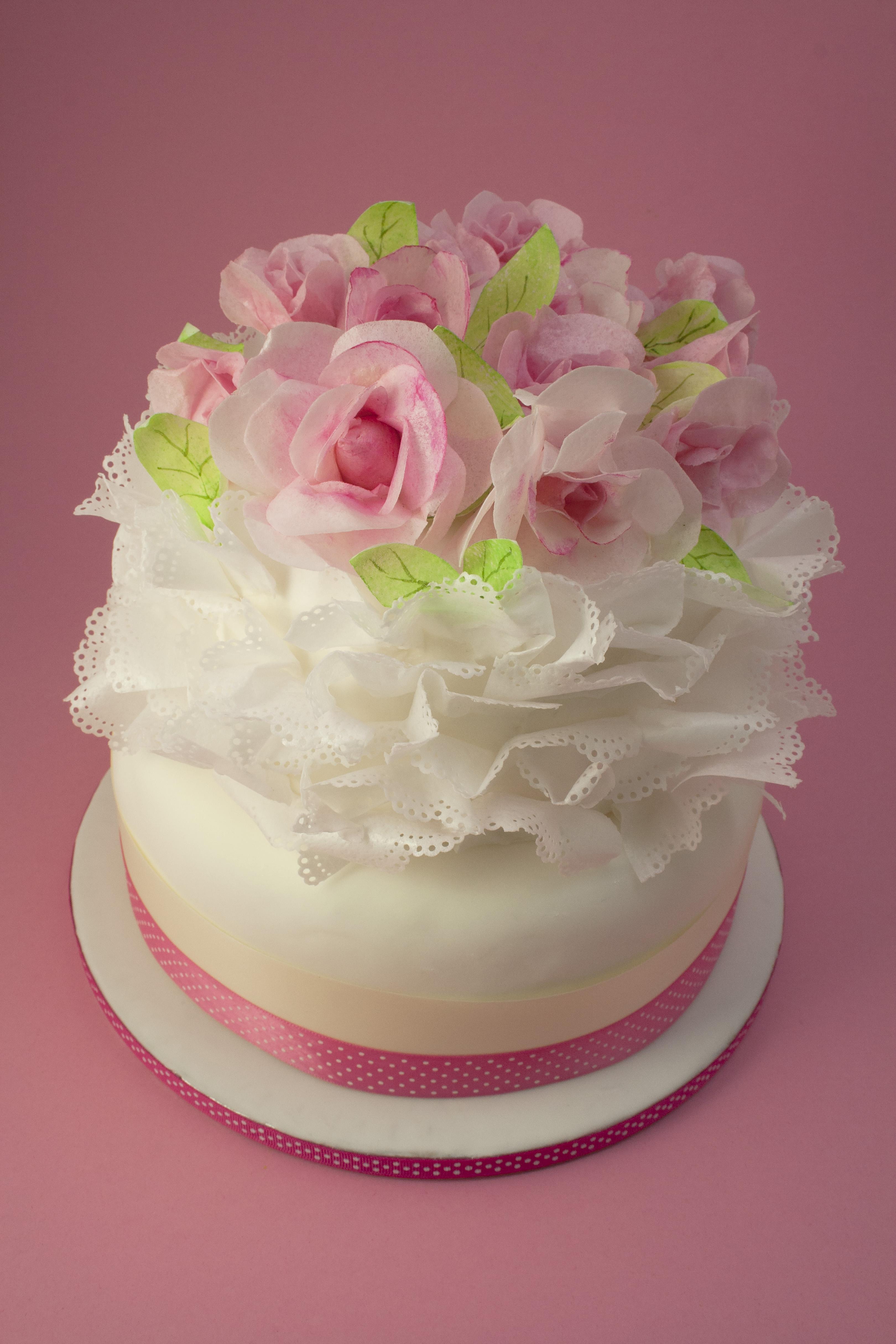 https://caroldeaconcakes.com/ruffles-roses/